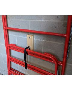Wall fixed storage pad and strap for trestles