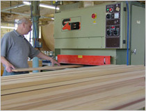 Planing timber in the joiners shop